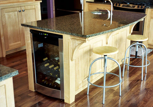 Elegant kitchen island made of European Beach wood by finewood Structures of Browerville, MN